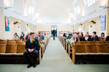 groom waits at church