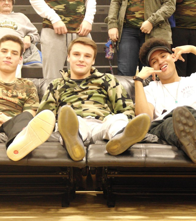 Senior jacket way winners Hayel Jomaa, Eric Eli, and Omar Vandiver enjoy their VIP seats next to the student section at the game.