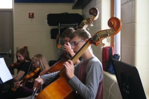 Two students playing bass