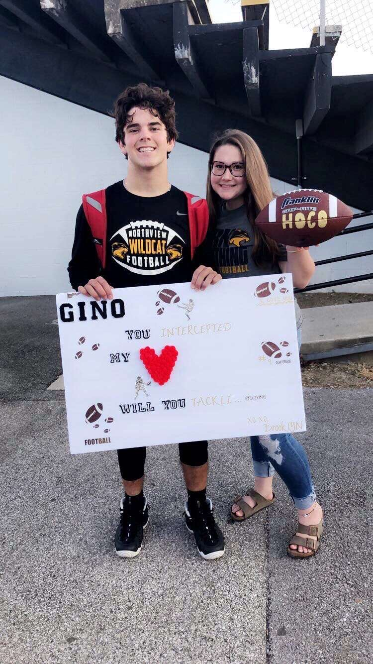 """Gino you intercepted my heart, will you tackle HOCO?"""