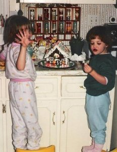 My sister (left) and me with our gingerbread house.