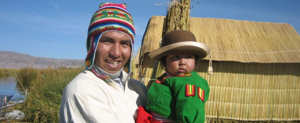 Man and Child - Uros, Peru