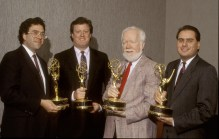 ESPN leaders Steve Bornstein, Steve Anderson, John Walsh and Bob Rauscher are shown holding Emmy Awards. (ESPN Images)
