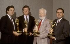 ESPN leaders Steve Bornstein, Steve Anderson, John Walsh and Bob Rauscher are shown holding Emmy Awards. (ESPN Images)