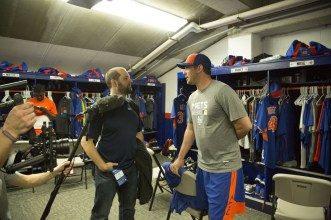 Matt Harvey with producer Ben Houser filming in the Mets locker room. (E:60)