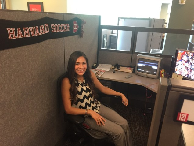 Erika at her desk in ESPN's programming office. (Kyle Van Fechtmann/ESPN)