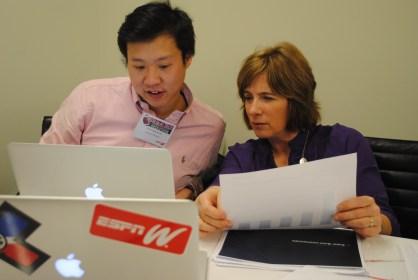 Chris Lin (L), web developer of Digital Media Partnerships, ESPN, and VP Content Program & Integration, Carol Stiff, prepare presentation slides. (Michelle Bashaw/ESPN)