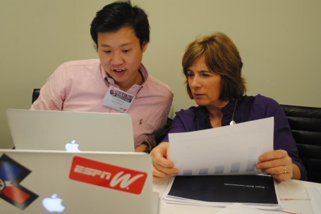 Chris Lin (L), web developer of Digital Media Partnerships, ESPN, and VP Content Program & Integration, Carol Stiff, prepare presentation slides. (Michelle Bashaw/ESPN)