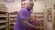 Former NBA star Shaquille O'Neal embraces Bruce Teilhaber, owner of Friedman's Shoes. (ESPN Films)
