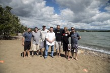 Olney (center, white shirt), Correa (third from right) and E:60 feature producer Max Brodsky (far right) stand on a beach in Correa's native Puerto Rico. (Max Brodsky/ESPN)