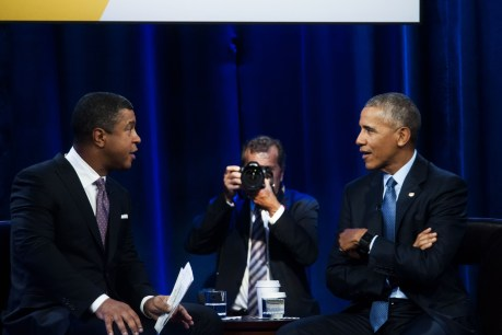 SportsCenter anchor Stan Verrett (L) met President Obama just moments before interviewing him. This photo depicts a conversation during a commercial break. (Jon Strayhorn)