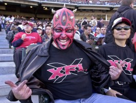 San Francisco Demons fan Mark Looney, from Pleasant Hill, Calif., shows off his XFL shirt during the first quarter against the Los Angeles Xtreme, Sunday, Feb. 4, 2001 in San Francisco in their first XFL game. (AP Photo/Paul Sakuma)