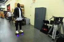 Draymond Green rides a hoverboard. (Joe Faraoni/ESPN Images)