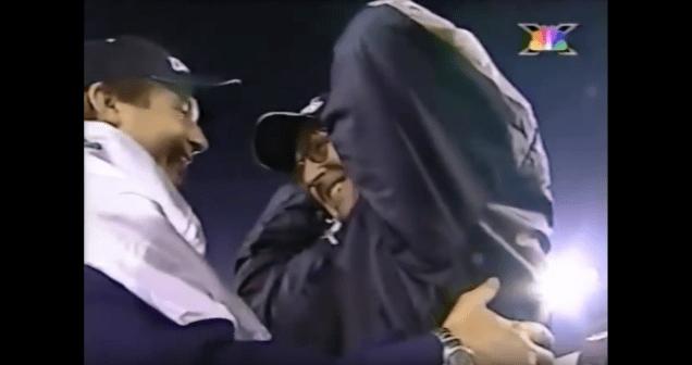 Tom (L) and Al Luginbill celebrate their 2001 XFL championship.
