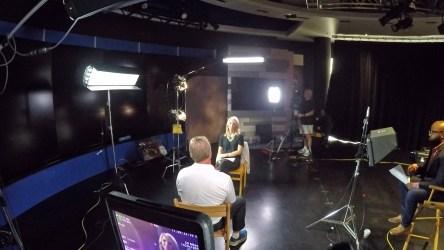 Luke Williams (far right) oversees Michelle Beisner Buck's interview with ESPN MNF analyst Jon Gruden. (Luke Williams/ESPN)