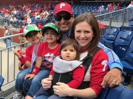 Kevin Negandhi with his wife Monica and their three kids at a Phillies game. (Photo courtesy of Kevin Negandhi/ESPN)