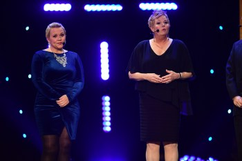 Holly Rowe (L) and Shelley Smith take the stage during the 2016 College Football Awards. (Phil Ellsworth/ESPN Images)