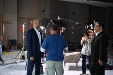 Derek Jeter (L) talks to ESPN producer Fernando Lopez (far right). (Joe Faraoni/ESPN Images)