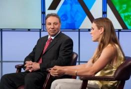 DiCicco discusses Title IX with U.S. women's national team star midfielder Heather O'Reilly. (Joe Faraoni/ESPN Images)