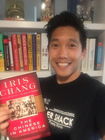 Cary Chow holds a copy of one of his favorite reads. (Photo courtesy of Cary Chow/ESPN)