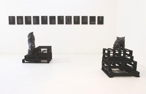 Nero (Alessandro Neretti), I nuovi apostoli ovvero Paesaggi economico-strutturali, 2012, terracotta smaltata, gres porcellanato, passepartout sagomati, legno, vernice nera, h194x810x392 cm