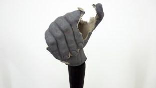 Loredana Longo, 2017, Fist, calco del pugno destro dell'artista in terraglia, esplosione e seconda cottura con ossido di rame, bastone in legno bruciato, anello in ferro, cm 140x300cm, courtesy Francesco Pantaleone, Milano