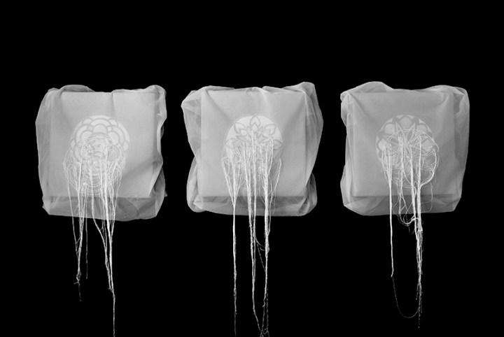 Manuela Toselli, Proiezioni distanti (installazione), 2015, seta, acrilico, filo di seta e filo di cotone - installazione divisibile, composta da 3 pz. (cad. cm 35,5x35,5)