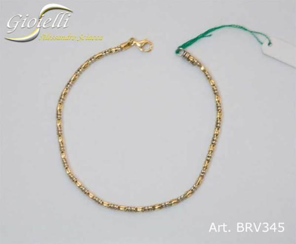Bracciale in oro maglia tubolare vuota bicolore. gr5.35 cm 22 oro giallo e bianco