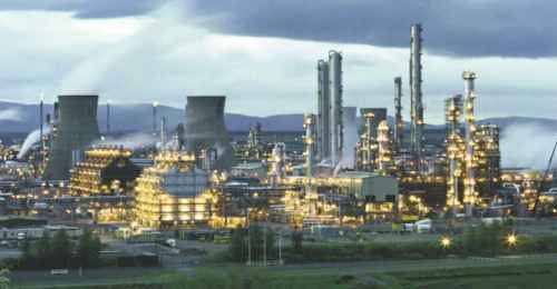 A panoramic photograph of the site at Grangemouth in Scotland at night where ethene is produced by steam cracking of naphtha.
