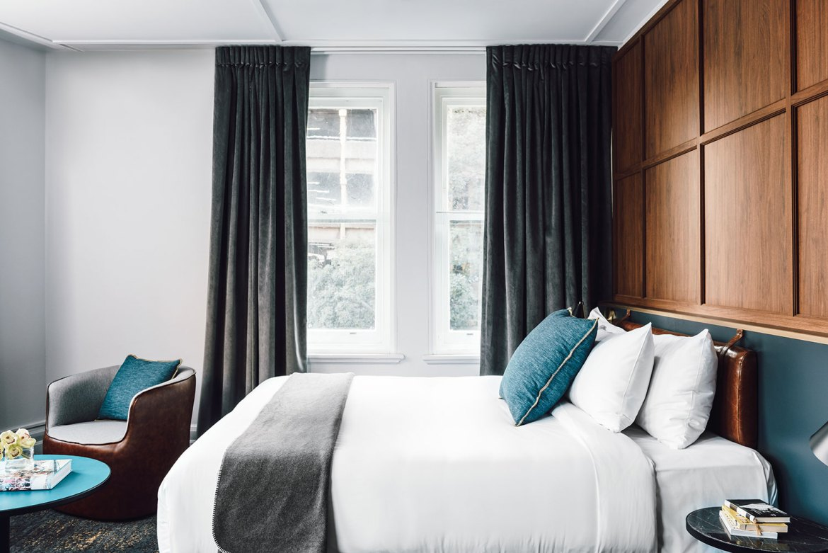 Walnut veneer wall panelling, plush bedding and retro furniture combine to make rooms elegant and appealing