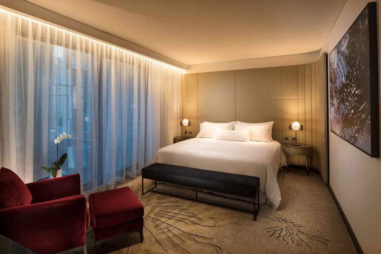 Plush interiors featuring King size beds and red velvet chairs adorn Weston's superb suites