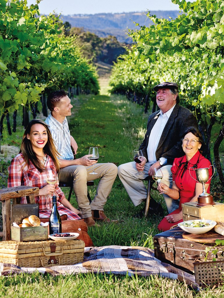 Bob and Dianne Curtis (right) with friends in their Yarra Valley vineyard