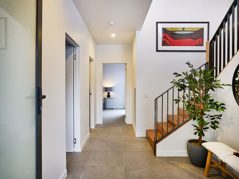Art House Townhouses feature large formal entry areas