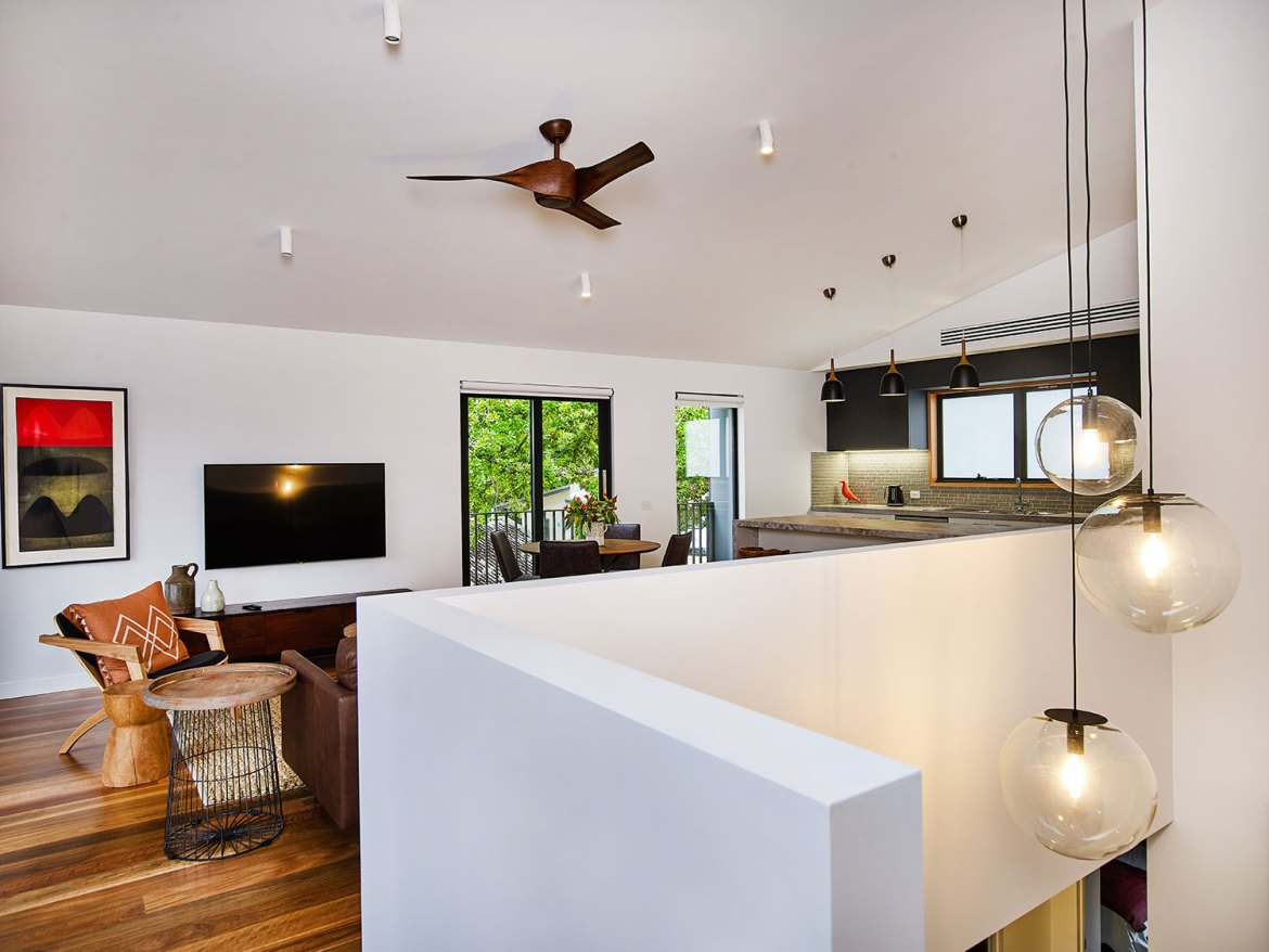 Wide stairwells feature with graduated-fall pendant dome lighting clusters