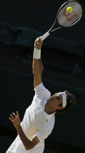 Roger Federer of Switzerland serves to Novak Djokovic of Serbia during their men's singles final match at the All England Lawn Tennis Championships in Wimbledon, London, Sunday, July 6, 2014. (AP Photo/Pavel Golovkin)