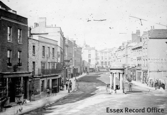One of Spalding's earliest photographs of the High Street c.1869. The Queen's Head can be seen on the left.