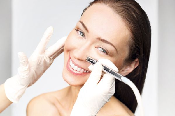 beautiful woman during cosmetic surgery on her face