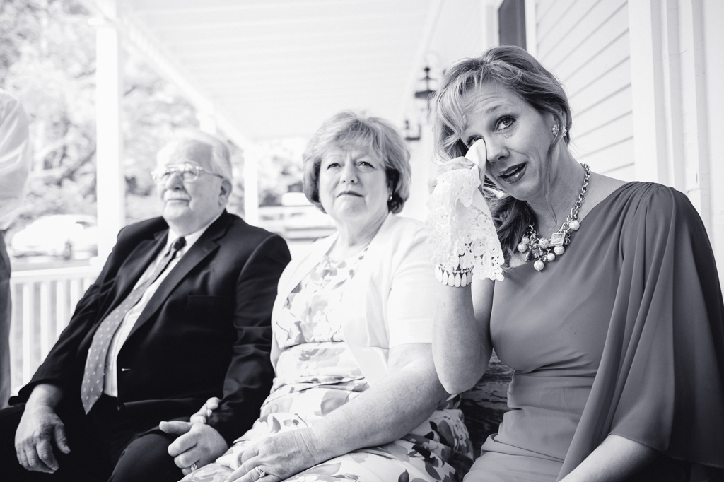 Mother of bride crying during intimate B&B wedding