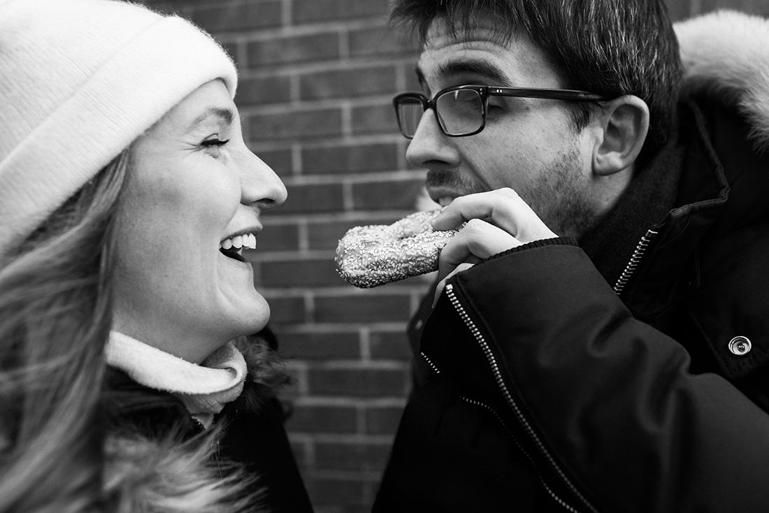 Lifestyle couple portrait eating Saint-Viateur bagels