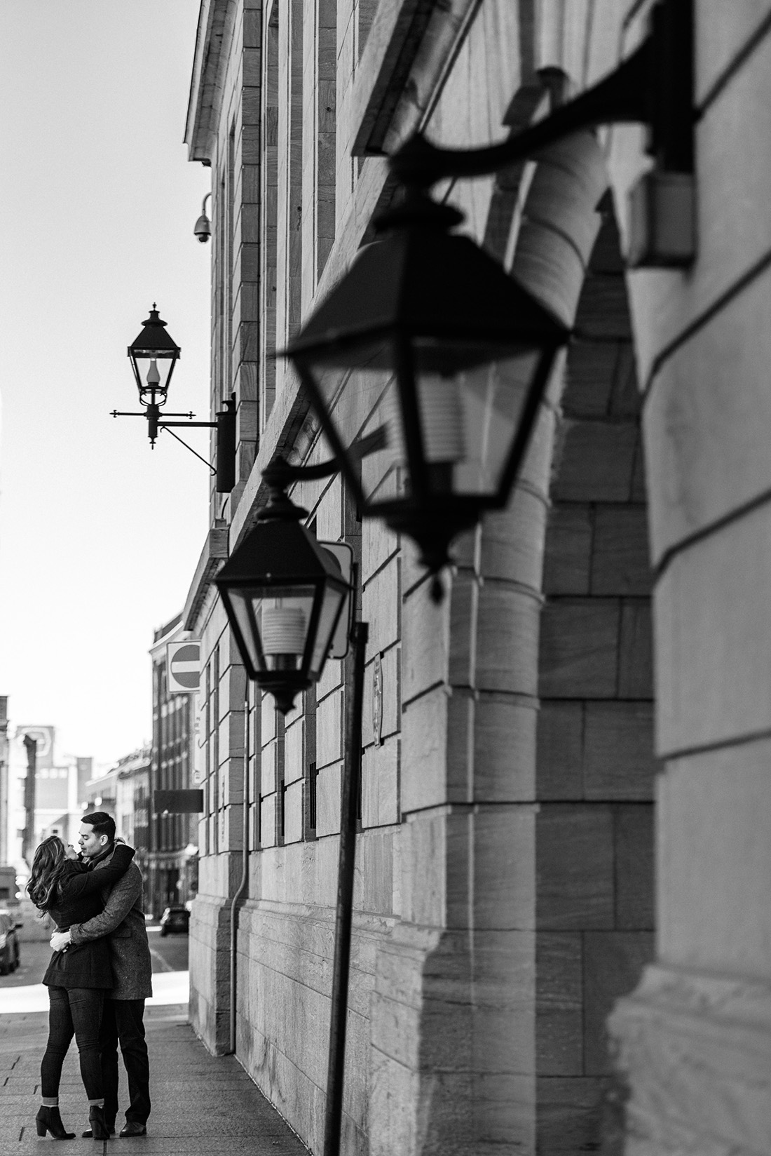Black and white engagement photo in Old Montreal, Quebec
