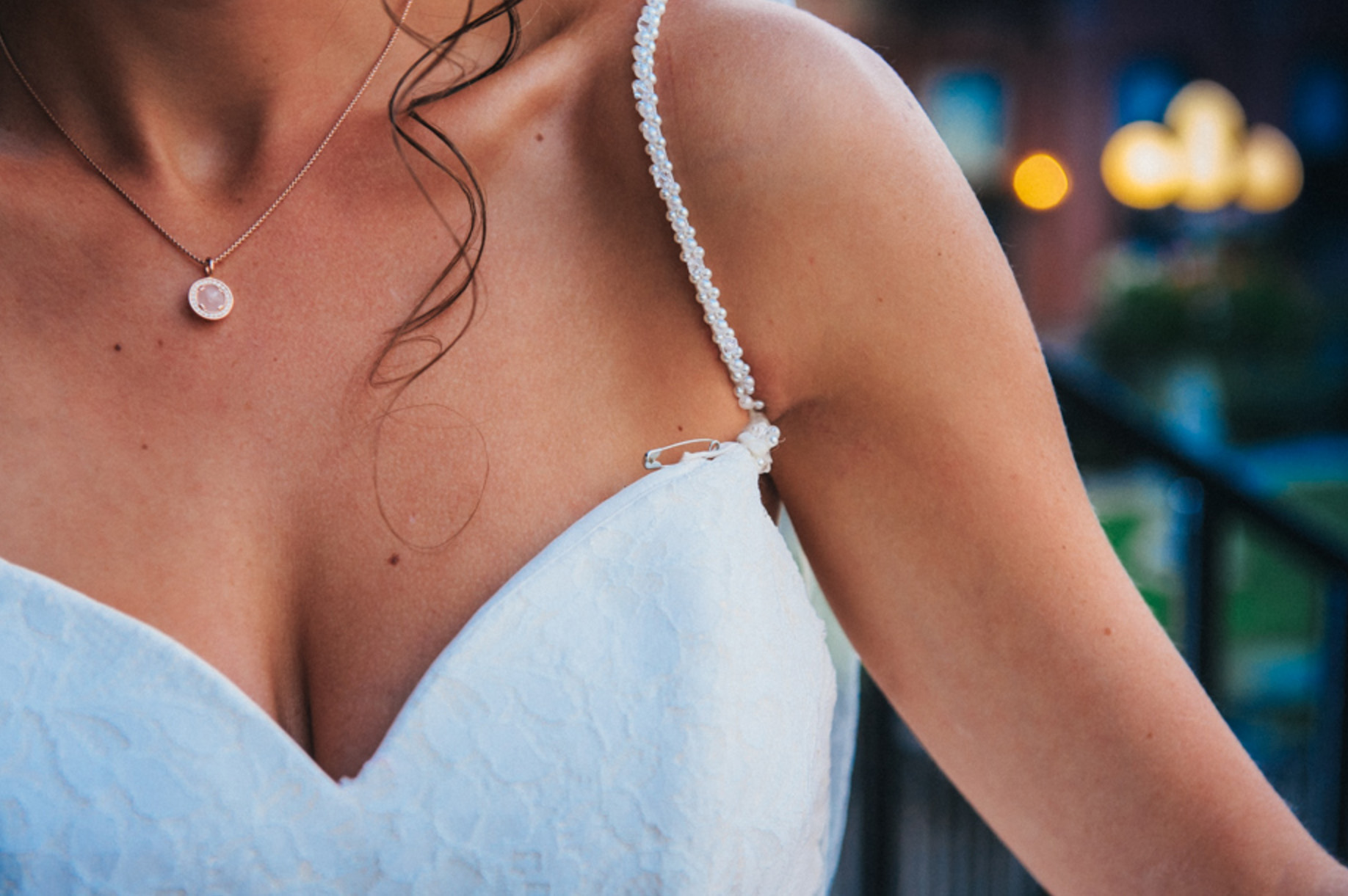 Award-winning wedding photo of bride's dress pinned with safety pin