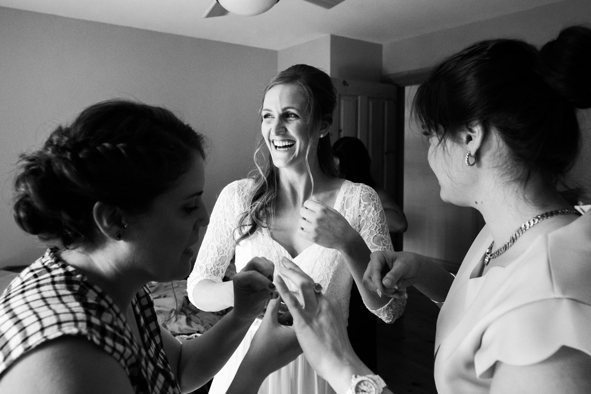 Photojournalistic coverage of bride getting ready with friends