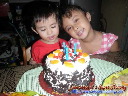 Filipino boy with birthday cake