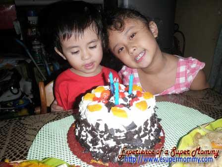 Filipino boy with birthday cake