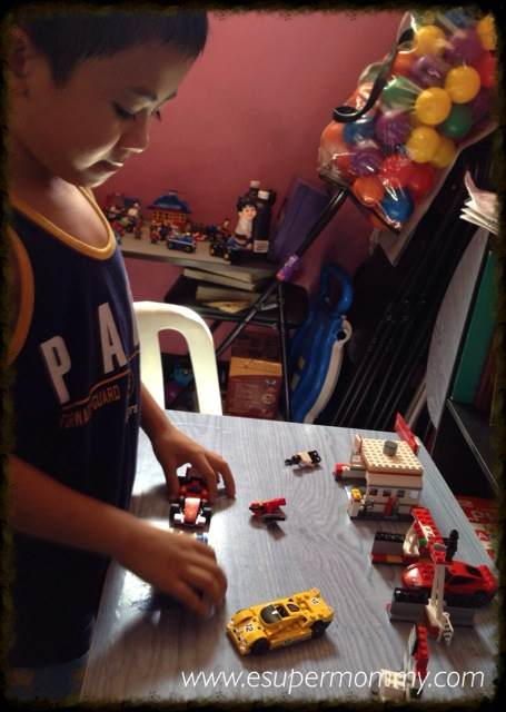 My Son playing Shell V-power Nitro+ Lego collection