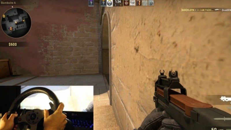 37634_10_gamer_uses_a_steering_wheel_to_play_counter_strike_full