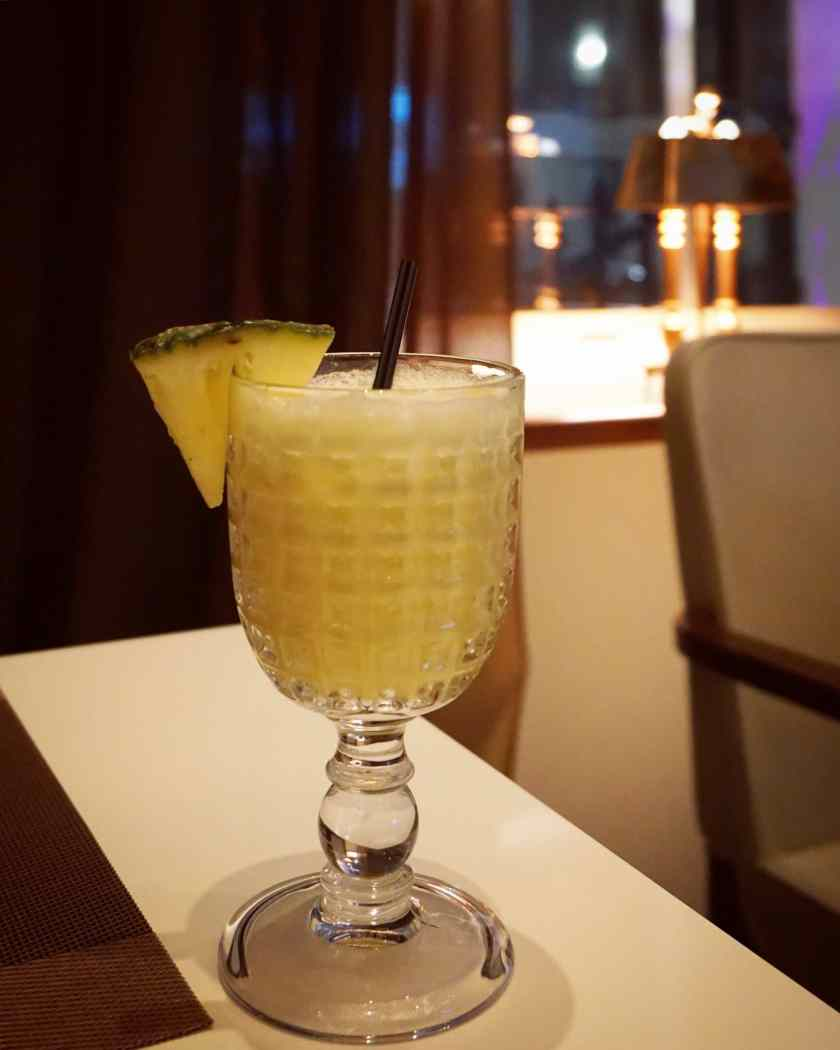 Image of a glass of tropical mocktail at Hankies Marble Arch