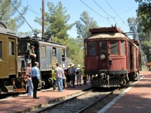 "Two PE ""home-brew"" cars (built in Torrance in 1925) and the big brown tower car (built in Los Angeles in 1915) with the author running it."