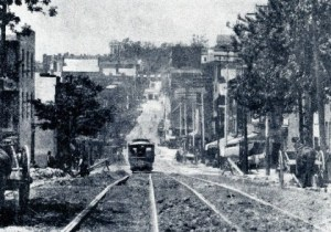 Frank Sprague's original electric streetcars travel up a Richmond, Virginia hill.
