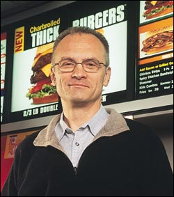 Carl's Jr. CEO Andrew Puzdur wants more burgers and less socialism